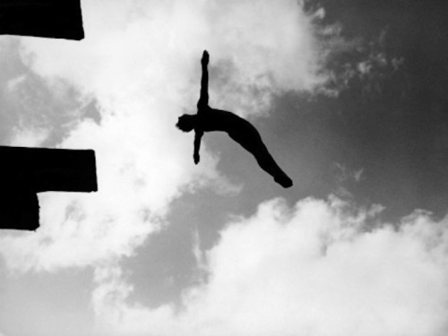 rex-hardy-jr-excellent-of-man-silhouetted-against-sky-doing-back-dive-off-high-board